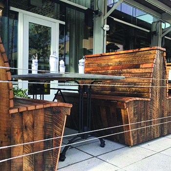 Benches for Fertitta's new restaurant Grotto Ristorante. Photo courtesy of Real Antique Wood.
