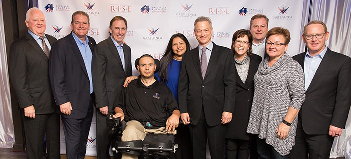 Left to right: Tommy Maxwell, Chris Zizza, Rick Holden, CPT Luis Avila, Claudia Avila, Gary Sinise, Barbara Titus, Michael Martin, Anita Howard, Jeff Fairbanks. Photo courtesy of Gary Sinise Foundation.